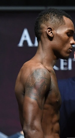 during their official weigh-in at the MGM Grand Garden Arena on December 12, 2014 in Las Vegas, Nevada.